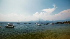 Afternoon time lapse of italian lake and blue sky stock video footage