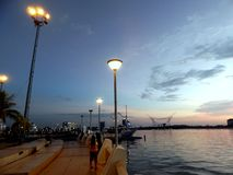The afternoon view of beachfront park at Losari Makassar, Indonesia stock photos