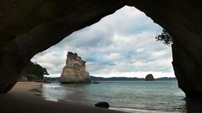 Afternoon view of cathedral cove. Afternoon view of the famous cathedral cove in new zealand stock video footage