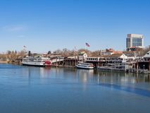 Afternoon view of Sacramento skyline with Sacramento River. Sacramento, FEB 21: Afternoon view of Sacramento skyline with Sacramento River on FEB 21, 2018 at stock images