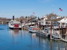 Afternoon view of Sacramento skyline with Sacramento River. Sacramento, FEB 21: Afternoon view of Sacramento skyline with Sacramento River on FEB 21, 2018 at royalty free stock photos