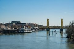 Afternoon view of Sacramento skyline with Sacramento River. Sacramento, FEB 21: Afternoon view of Sacramento skyline with Sacramento River on FEB 21, 2018 at stock photos