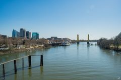 Afternoon view of Sacramento skyline with Sacramento River. Sacramento, FEB 21: Afternoon view of Sacramento skyline with Sacramento River on FEB 21, 2018 at royalty free stock photo