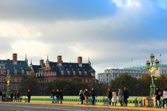Afternoon walkers traverse Westminster bridge late autumn royalty free stock image