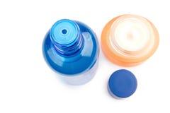 aftershave błękitny śmietanka odizolowywający tubki biel Fotografia Royalty Free