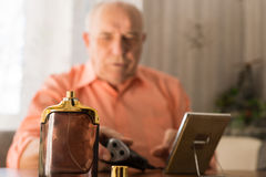 Aftershave Bottle In Front Old Bald Man Stock Photos