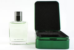 Aftershave lotion. A bottle of aftershave lotion and its package on a white background Royalty Free Stock Images