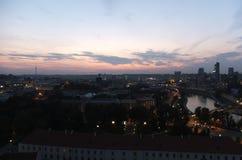 Afton över staden Arkivfoto
