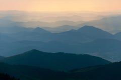 Afton färgad sikt av blåa horisonter Fotografering för Bildbyråer