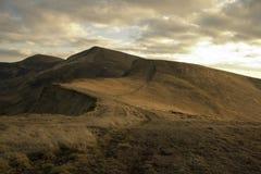 Afton i berg i höst Fotografering för Bildbyråer
