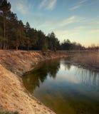 Afton på floden Arkivbild