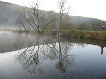 Afton på sjön Arkivbild