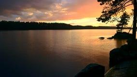 Afton på sjön Fotografering för Bildbyråer