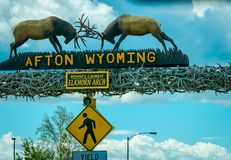 Afton, Wyoming, United States - June 07, 2018: Outdoor view of the world`s larges elkhorn arch at the entrance of the. Town in a cloudy sky background during a stock photography
