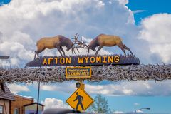 Afton, Wyoming, United States - June 07, 2018: Outdoor view of the world`s larges elkhorn arch at the entrance of the. Town in a cloudy sky background during a royalty free stock images