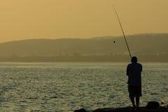 Aftonfiske Fotografering för Bildbyråer