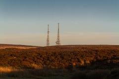 Aftonljus på bergstoppet med radiomaster Royaltyfria Foton