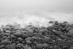 Aftontidvatten på stranden Royaltyfri Bild