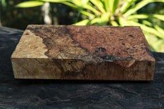 Afzelia burlträ som göras randig för bil för garnering för bildtryckinre, den exotiska trähärliga modellen för hantverk eller abs arkivfoto