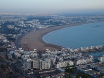 AGADIR travel city landscape in Morocco. With white buildings on cityscape and beach at Atlantic Ocean at evening in 2016 winter day - aerial view, Africa on Royalty Free Stock Photos