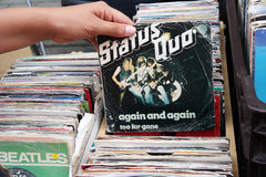 Again and again. BELGIUM - JULY 2014  Single record of the English rock band Status Quo on a flea market Stock Photo