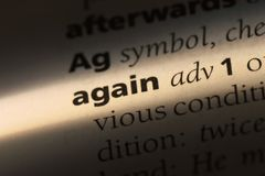 Again. Word in a dictionary.  concept royalty free stock photos