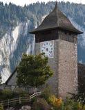 Agains della torre di orologio le alpi Fotografia Stock Libera da Diritti