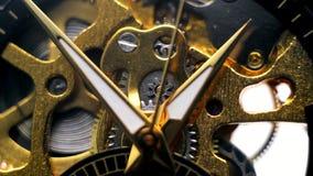 Against backdrop of clockwork mechanism, coming hands of clock