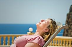 against backdrop coastal lady senior sunbathing Στοκ φωτογραφίες με δικαίωμα ελεύθερης χρήσης