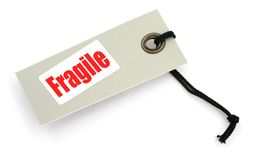 against background fragile tag white Стоковые Фотографии RF