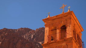 Against the background of the mountains the bell tower in the monastery of St. Catherine stock footage
