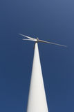 Wind turbine. Against blue power sky station wind Stock Photo