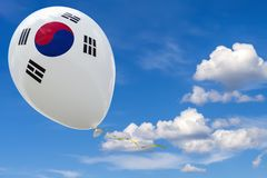 Against the blue sky flying balloon with the image of the state flag of the South Korea. 3D visualization, illustration with copy space royalty free illustration
