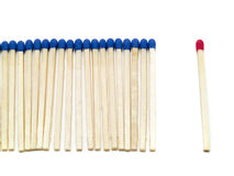 Against the Croud!. One different match stick isolated on white background Stock Photography
