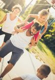 Against each other. Family playing basketball. Close up royalty free stock photos