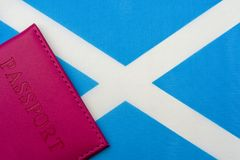 Against the flag of Scotland is a passport. The concept of travel and tourism stock images