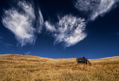 Against the Sky. A small hut under a vivid cloudy sky Royalty Free Stock Photo