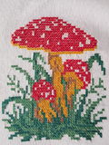 Agaric mushrooms. On white fabric suitable as background, needlework Stock Photos