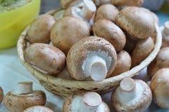 Agaricus bisporus - Fresh raw mushroom champignon wicker baskett Royalty Free Stock Photos