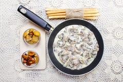 Agaricus mushroom sauce in frying pan Stock Photography