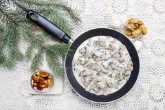 Agaricus mushroom sauce in frying pan Royalty Free Stock Images