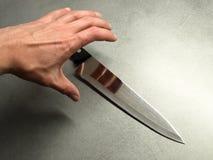 Agarre uma faca Fotos de Stock