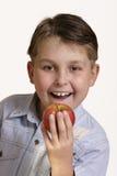 Agarre uma maçã Foto de Stock Royalty Free