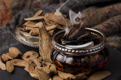 Agarwood incense. Agarwood, also called aloeswood incense chips stock photo