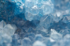 Agate is a cryptocrystalline variety of crystal quartz. Macro. Texture aquamarine crystals Stock Photography