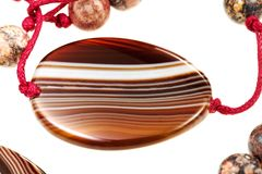 Agate gemstone in lady's bead Royalty Free Stock Images