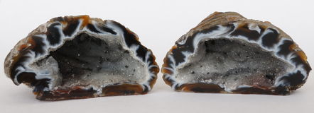 Agate geode pair. Agate geode filled with Quartz crystals. These Agate geodes are also called Flame Agates and are found in Brazil Royalty Free Stock Photography