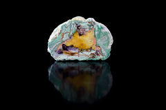 Agate stone on mirror surface. Black background Royalty Free Stock Photography