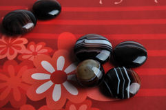 Agates on red background Royalty Free Stock Photos