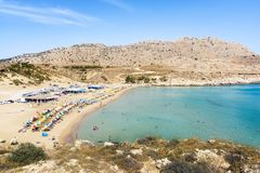 Agathi beach with holiday makers enjoying their time Rhodes, Greece stock photos